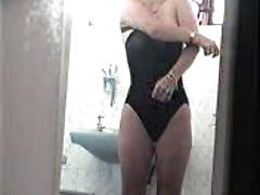 Voyeur Mature Changing out of Swimsuit