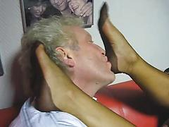 Mature Gives Man A Sexy Footjob On A Couch