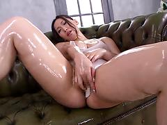 Chubby Asian hottie oils herself and toys her dripping cunt
