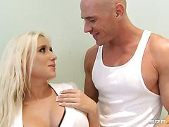 Sporty blonde with fake tits fucks with her muscled coach in the gym