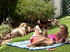Wet lesbian sex dolls finger and toy starving pussies on the grass
