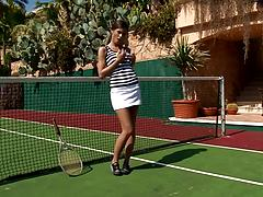 Fabulous tennis player in a white miniskirt plays a solo on the court