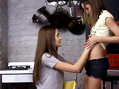 Lesbian partners lick tits and snatches of each other in a kitchen